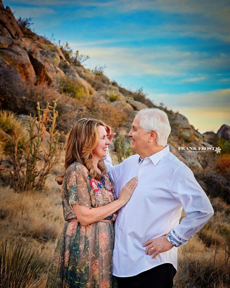 couple in photography in front of desert landscape